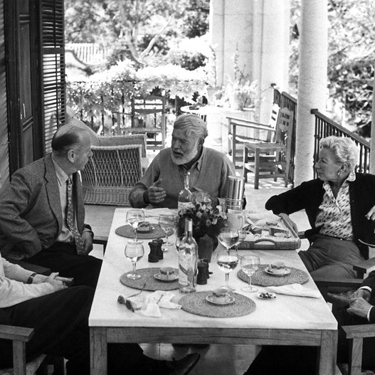 EH 2263S  Luncheon at La Consula, Malaga, Spain, 1959. L-R: Bill Davis, Rupert Belleville, Ernest Hemingway, Mary Hemingway, Juan Quintana. Photograph in the Ernest Hemingway Photograph Collection, John F. Kennedy Presidential Library and Museum, Boston.