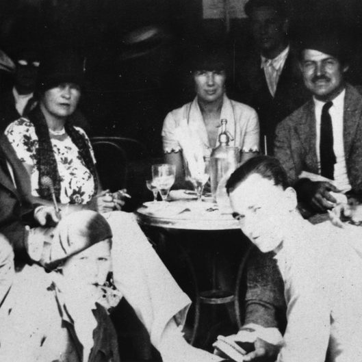 EH 6949P  Pamplona, Spain, summer 1926. L-R (at table): Gerald Murphy, Sara Murphy, Pauline Pfeiffer, Ernest Hemingway and Hadley Hemingway. Photograph in the Ernest Hemingway Photograph Collection, John F. Kennedy Presidential Library and Museum, Boston.